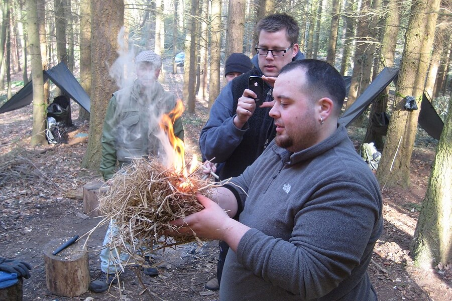 Scout leader successfully achieving fire-by-friction