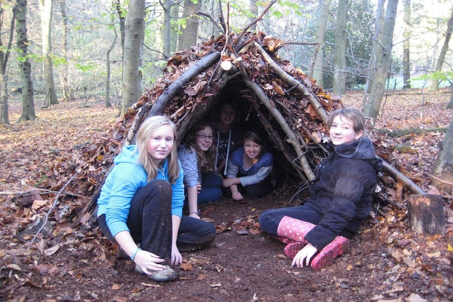 Natural shelter building as part of a survivor challenge