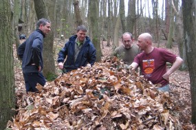 One of the teams building their natural debris shelter ready  for sleeping out in the woodlands