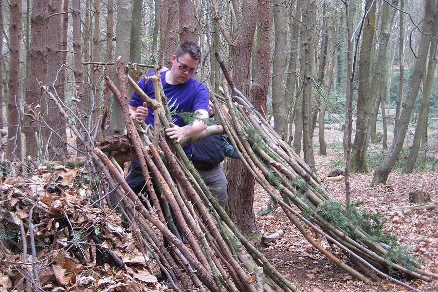 Youth leaders building a natural shelter