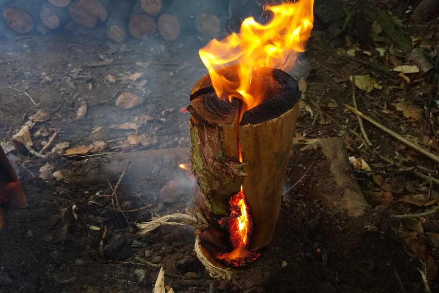Rocket stove flames leaping out of the top