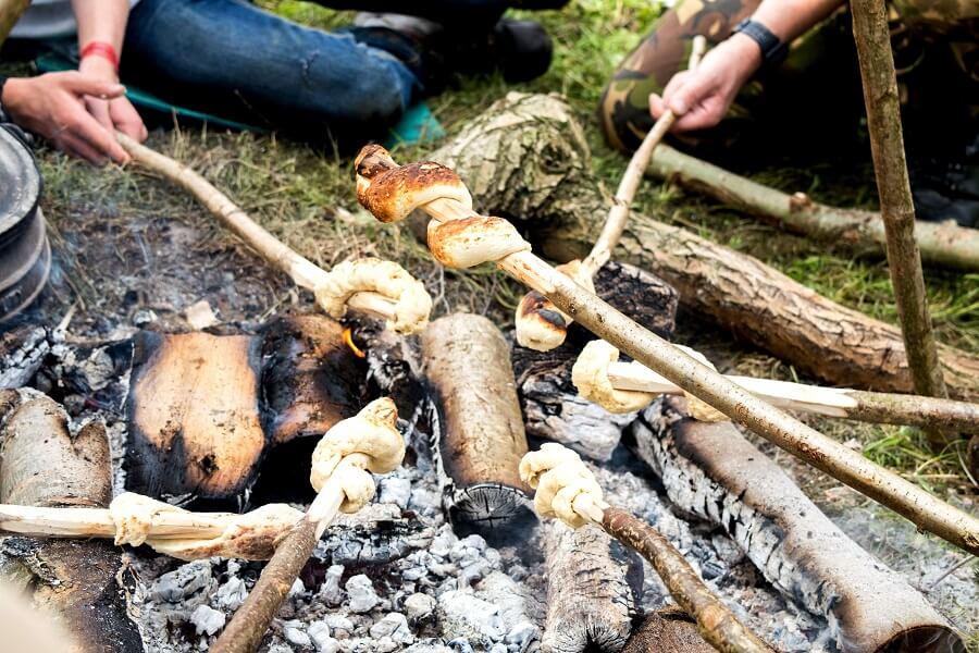 Baking bannock on the campfire