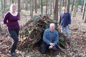 Youth leaders build a natural shelter